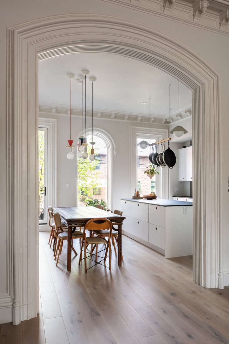 This eclectic brownstone kitchen combines modern Ikea cabinets with vintage furniture, artful lighting, and classic architectural details. Photograph by Alan Tansey, courtesy of vonDALWIG Architecture, from Second Time's the Charm: 'A Renovation of a Renovation' in a Brooklyn Duplex.