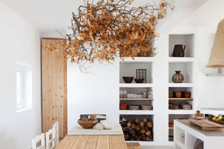 Eat-in kitchens aren&#8\2\17;t just for large spaces. Case in point: this cozy guesthouse kitchen in Portugal, with sculptural white shelves and a simple wood-plank table. Photograph by Sanda Vuckovic via Cucumbi, from Cucumbi: A Rustic Guest House in Portugal, Suited for Autumn.