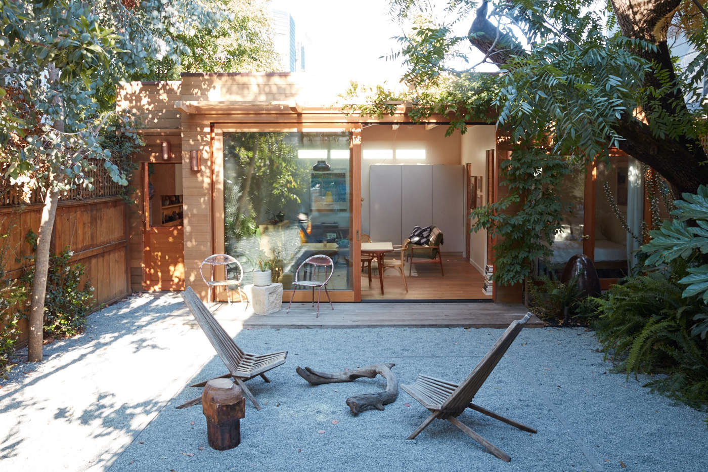This remarkable transformation actually involved a dilapidated shed (and not a garage) but its design lessons can be easily applied to a garage conversion as well. See Before & After: A Derelict Shed in San Francisco Transformed Into an Artist's Studio.