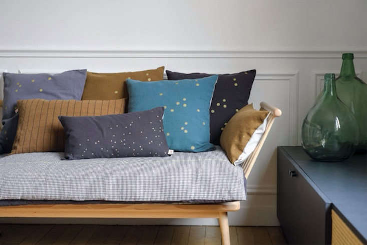 Take a page from the French and cover the seat of your sofa with a characterful throwbed. See 7 Favorites: Soft, Stylish Throwbeds (Starting at \$50).
