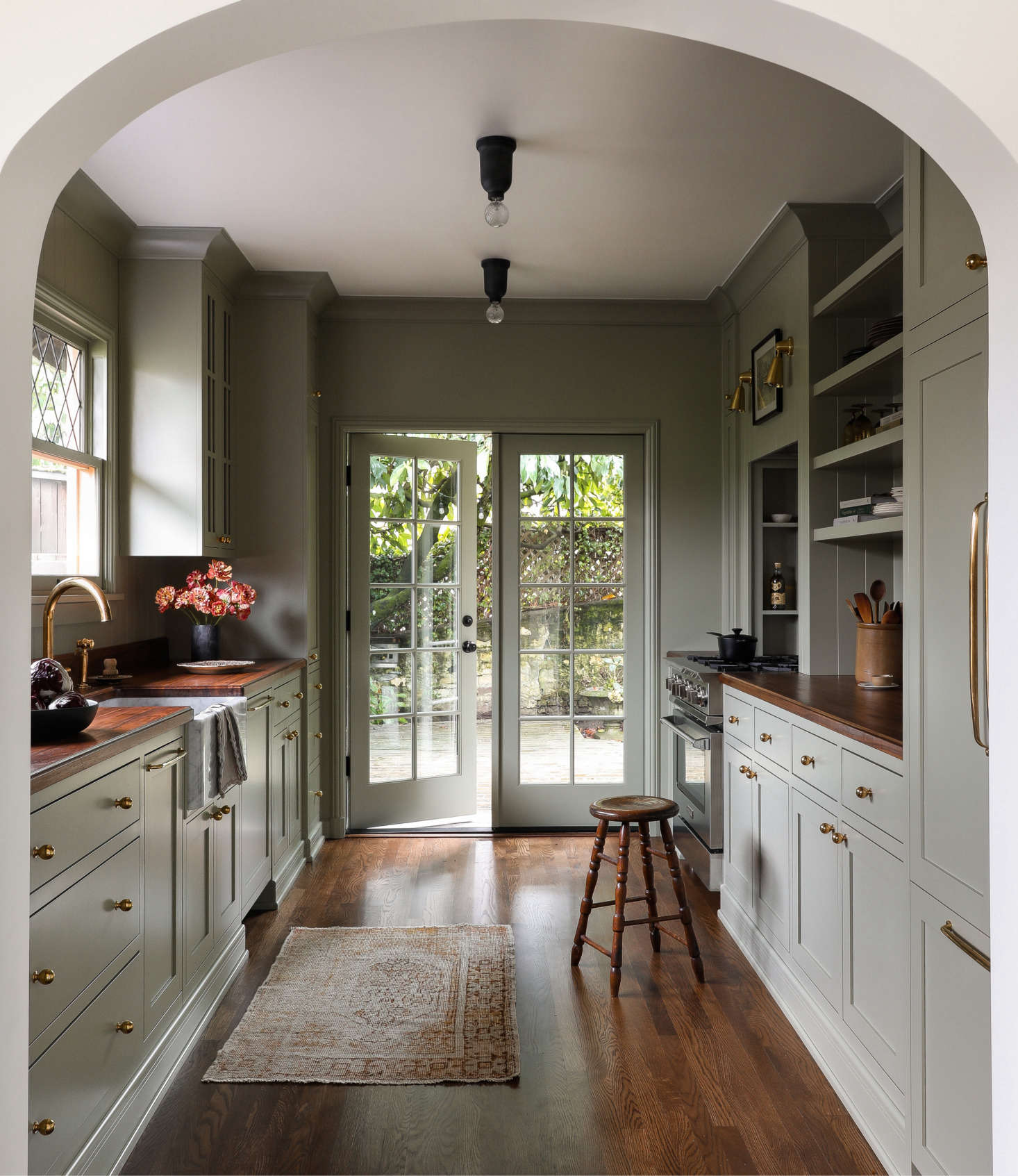Find out which Farrow & Ball color designer Heidi Caillier chose for this galley kitchen in English-Style in Seattle: A Couple's Longtime Home Gets an Anglo Update. Photograph by Haris Kenjar, courtesy of Heidi Caillier Design.