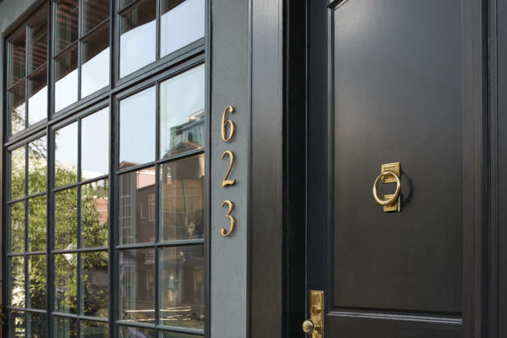 """Brass looks particularly striking against a dark background. The house numbers are the 6"""" Traditional House Numbers ($60 each)."""