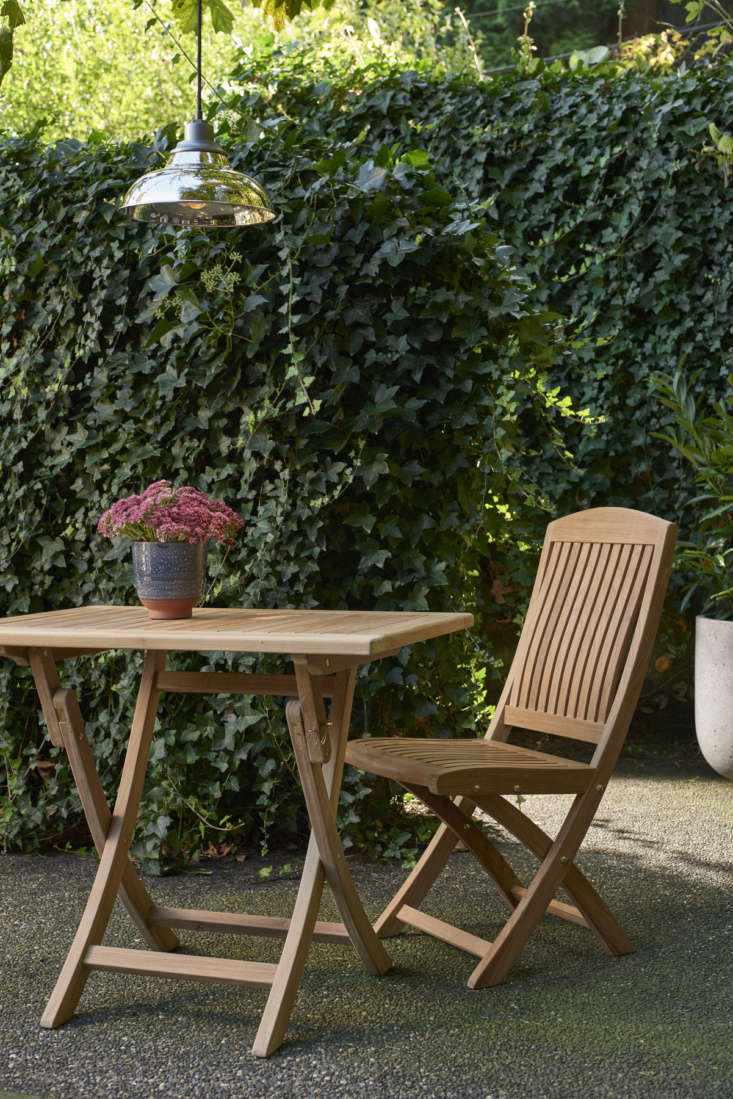 Rejuvenation's design-forward outdoor furniture collection includes the Teak & Brass Folding Side Chair ($499) and Teak & Brass Folding Table ($999), both made of sustainably sourced solid teak and brass details, both fully collapsible.