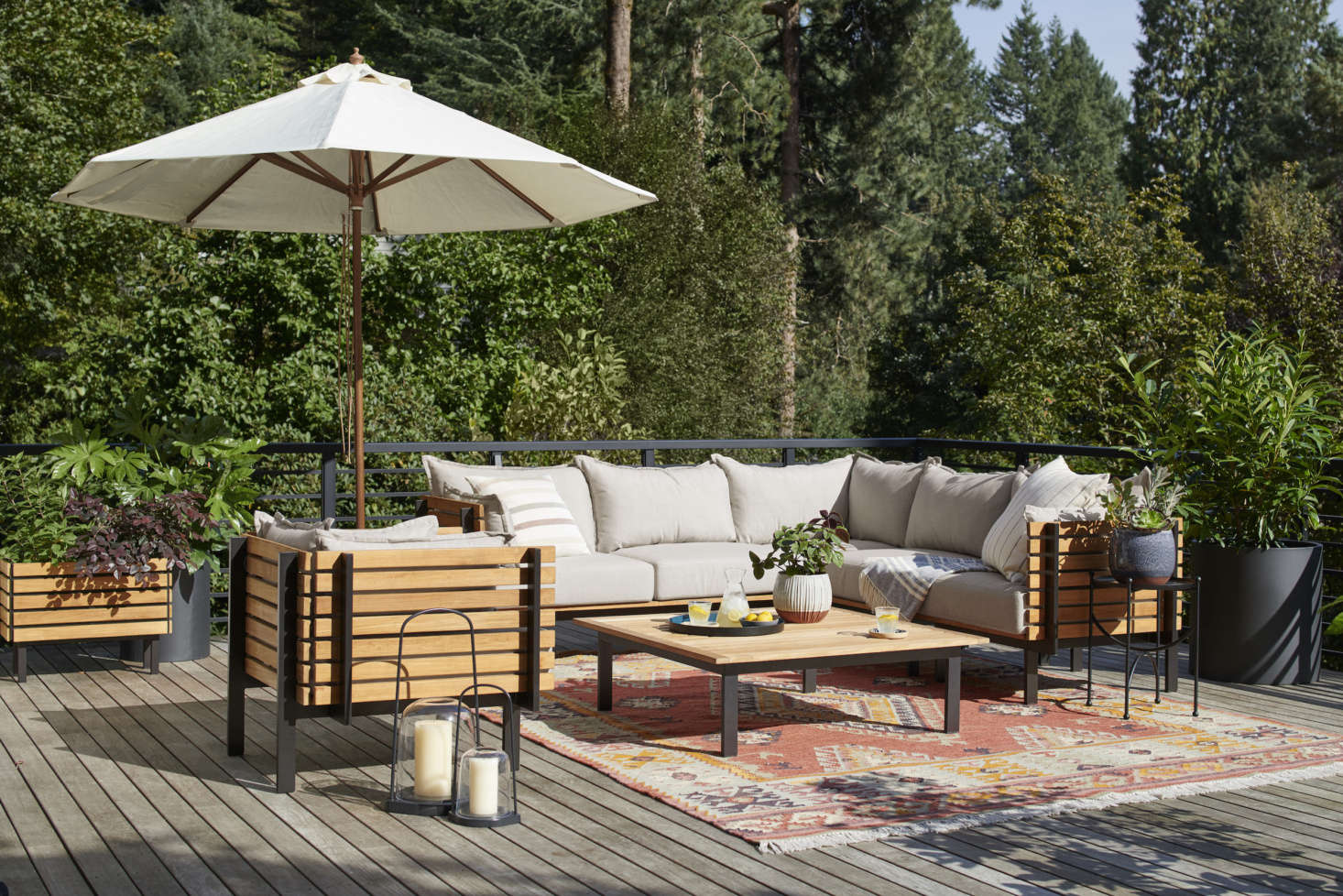 Outdoor furniture from the Jasper collection—like the Jasper Three-Piece Teak Sectional Sofa ($4,997) and Jasper Teak Arm Chair ($src=