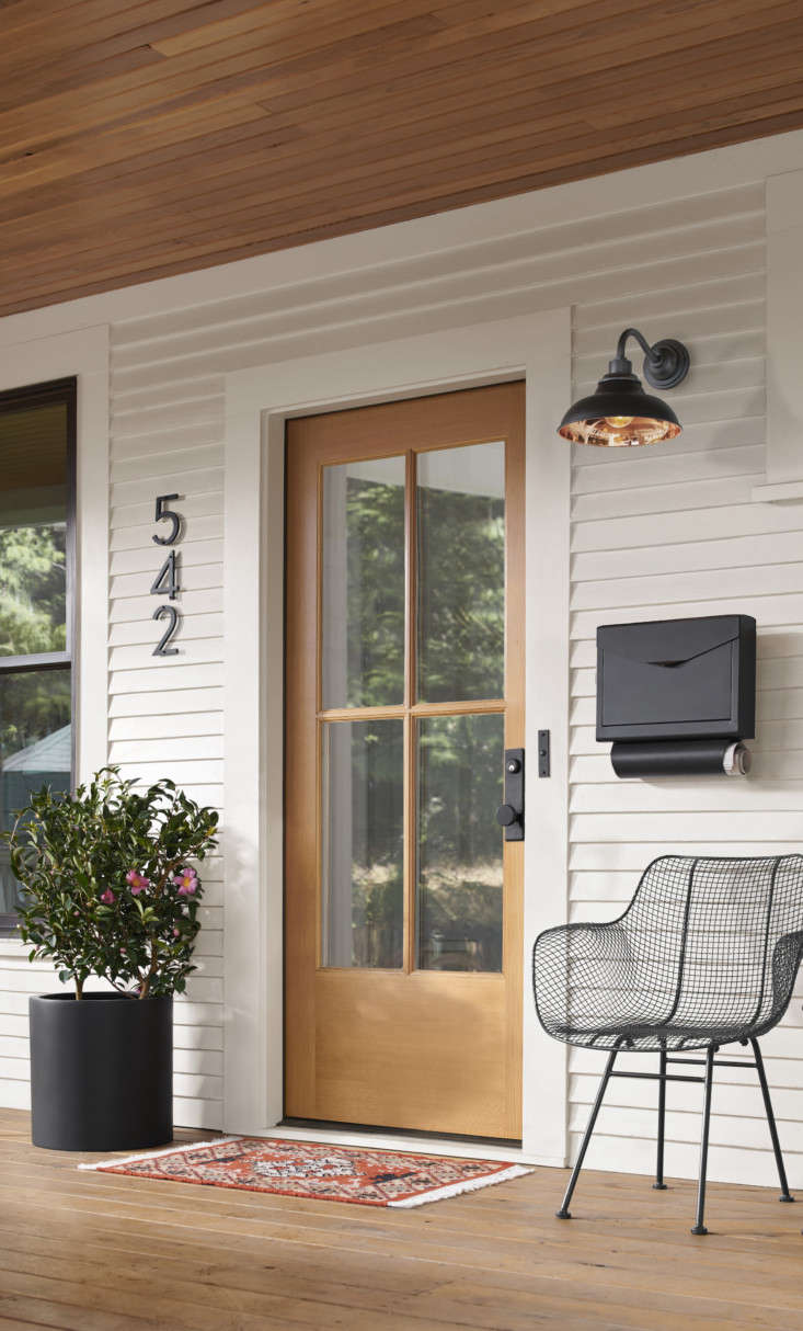 Or, create a petite welcome spot on the front porch: An Emily Locking Wall-Mounted Mailbox ($90) provides a one-stop shop for collecting mail and magazines at the end of the day, while a Carson loading=