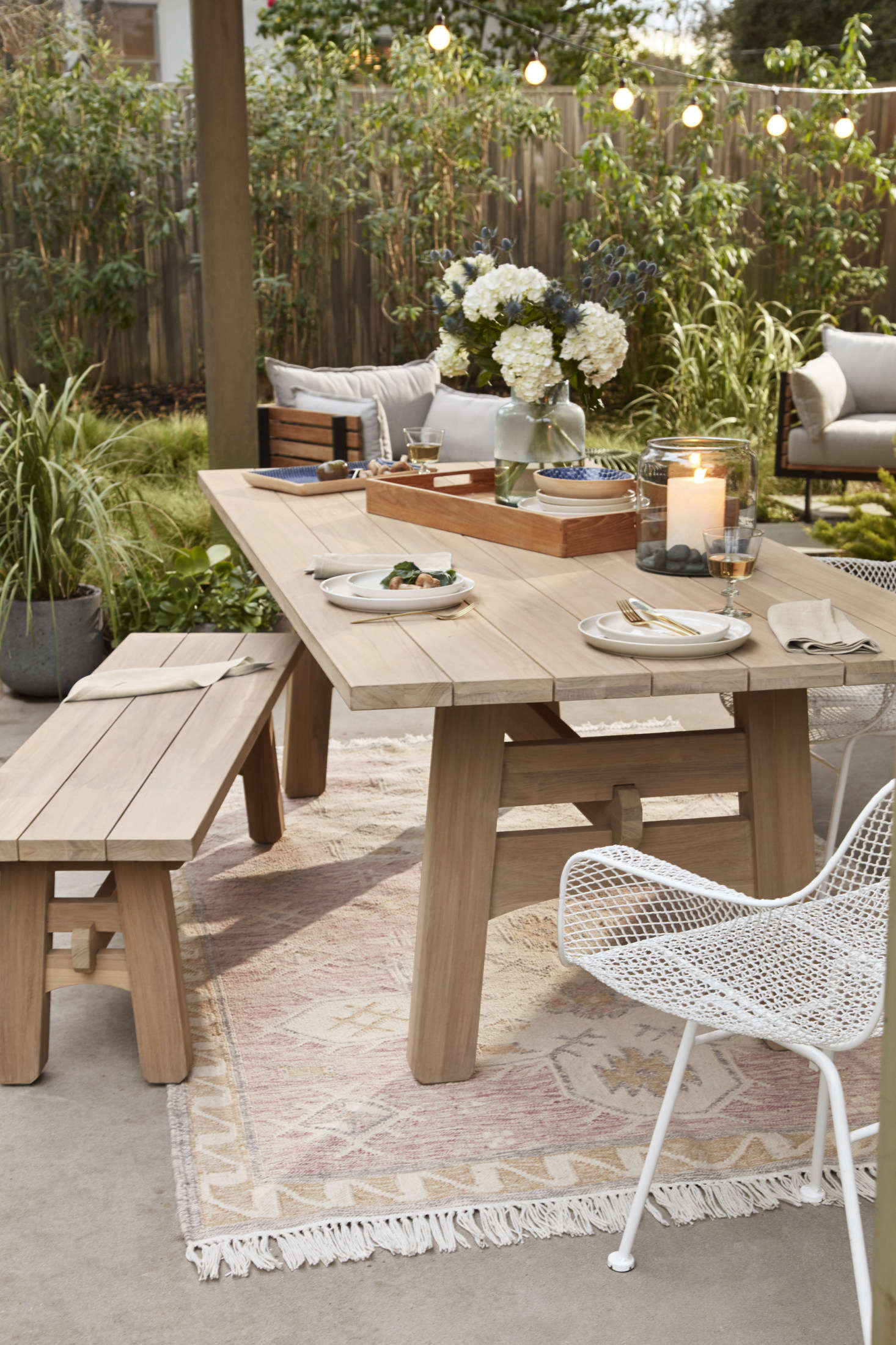 A serene set-up for dinners outdoors: the Ronde Teak Dining Table ($src=