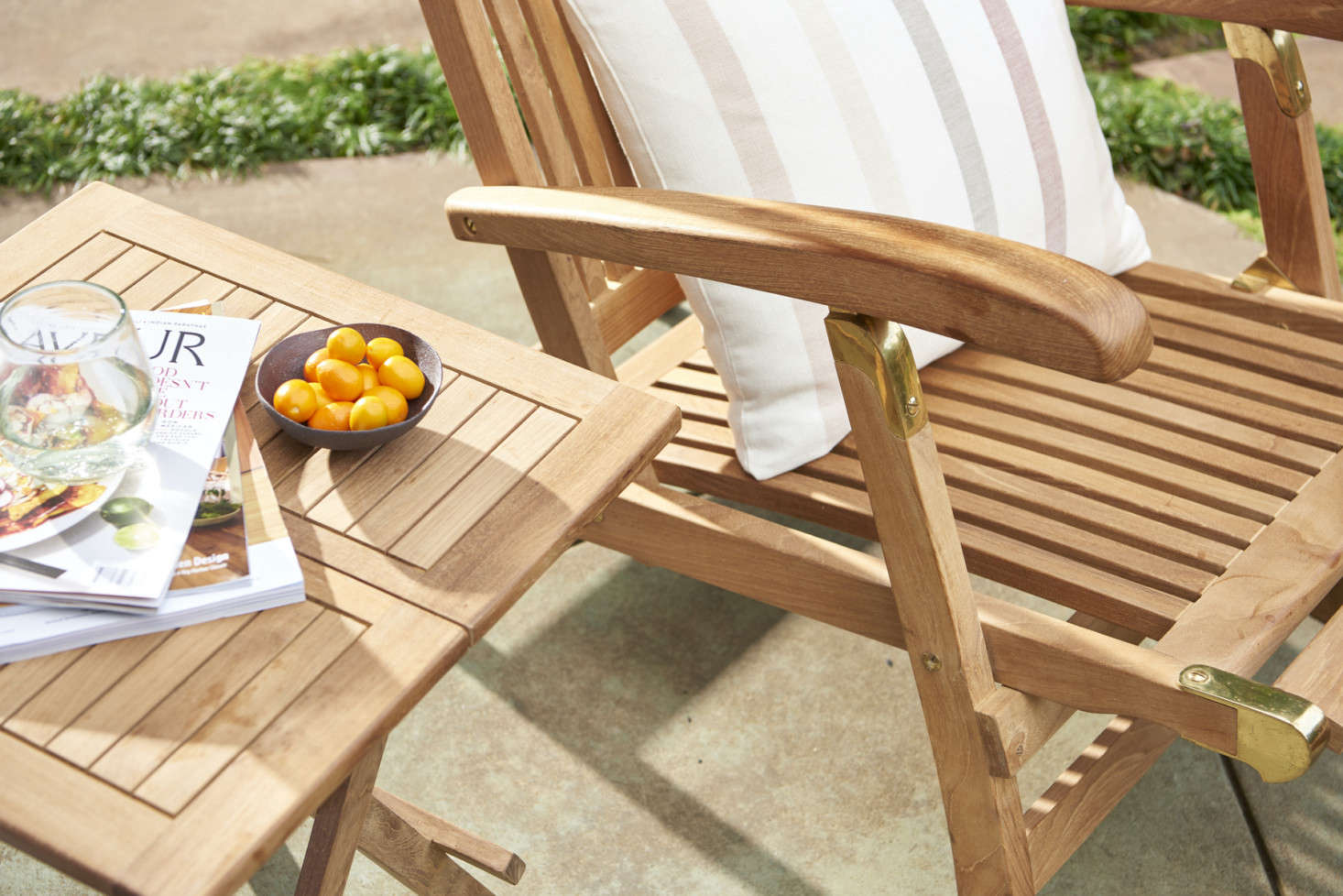 Make sure to add a Teak Folding Side Table ($9) alongside for keeping a glass of lemonade within easy reach.