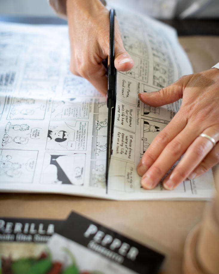 Measure and cut newsprint strips that are about twice the height of the pot maker base. If you don&#8