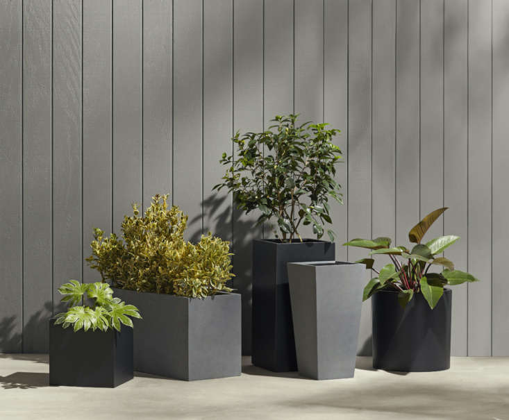 "These industrial-style planters only look metal—but they're actually made of lightweight, frost-proof fiberstone composite. They're available in black or grey as well as a variety of sizes and shapes; we like the Modern Fiberstone Square Planter ($9; far left) and the long, low Modern Fiberstone Rectangle Planter ($9; second from left) for separating outdoor ""rooms"" on a patio."