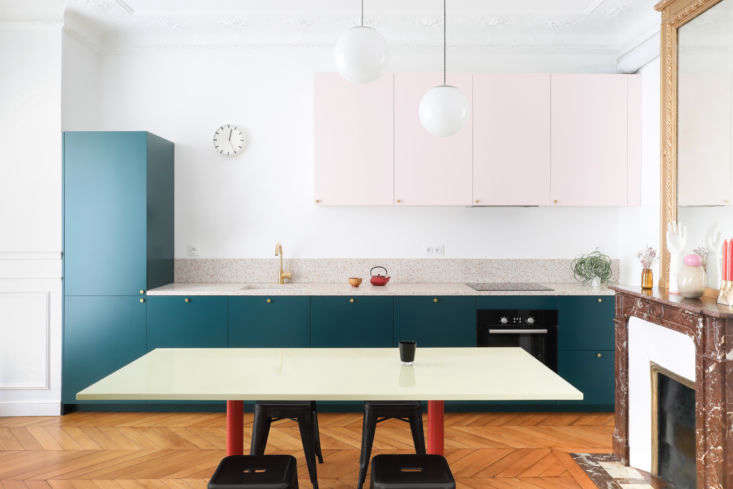 A small Paris apartment is given a colorful makeover in A Classic Paris Apartment Gets a Color-Blocked Update for Two Graphic Designers. Photograph courtesy of Heju Studio.