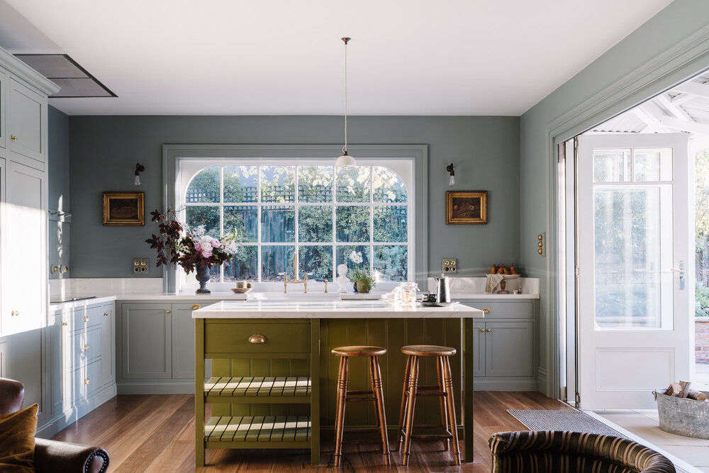 A spring-like palette for the cabinets and island in the kitchen of Lumiere Lodge. Photograph by Marnie Hawson, courtesy of Lumière Lodge, from A Couple's Thoughtfully Hued Antique Cottage Down Under.