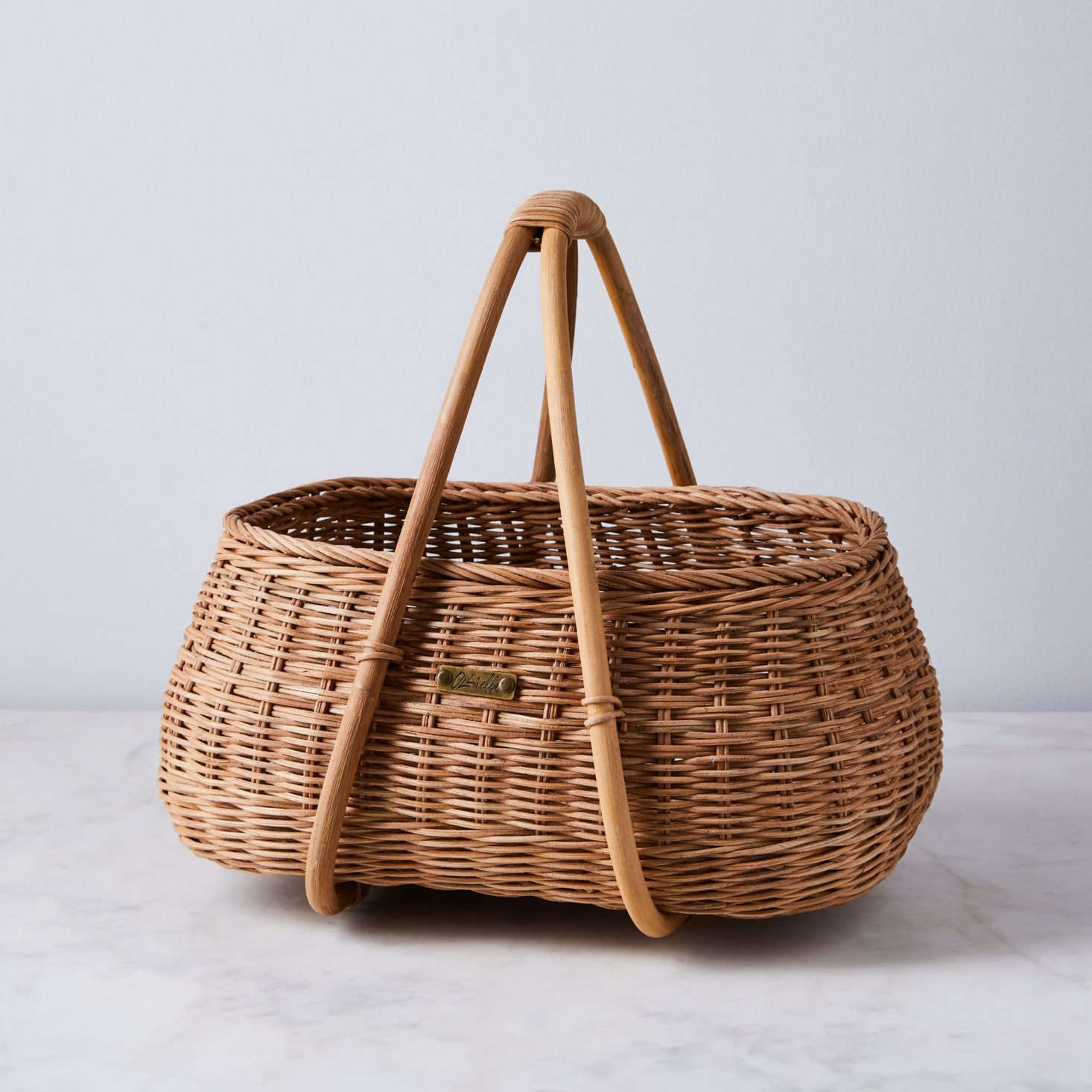 The woven rattan Mosey Basket with bamboo handles from Olli Ella is equally great for equally great for vegetable garden harvests and farmer&#8