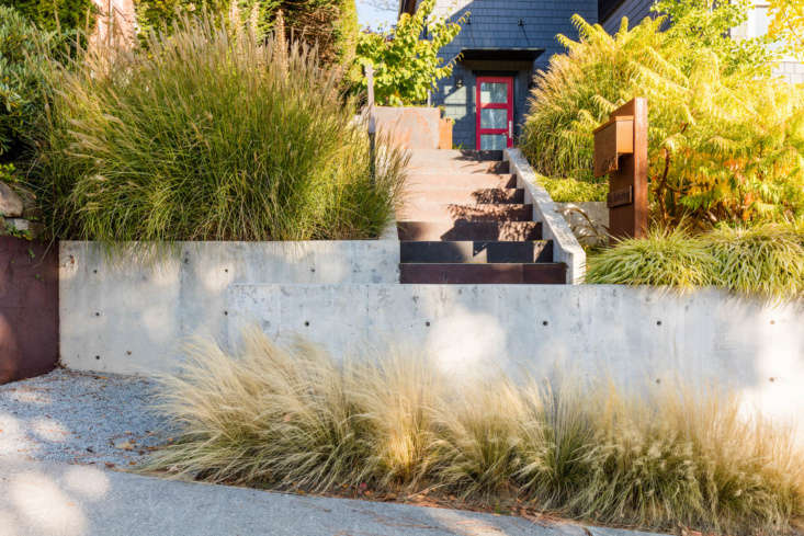The house now has curb appeal thanks to new retaining walls and stairs. Billowing grasses greet visitors as they walk up the steps.