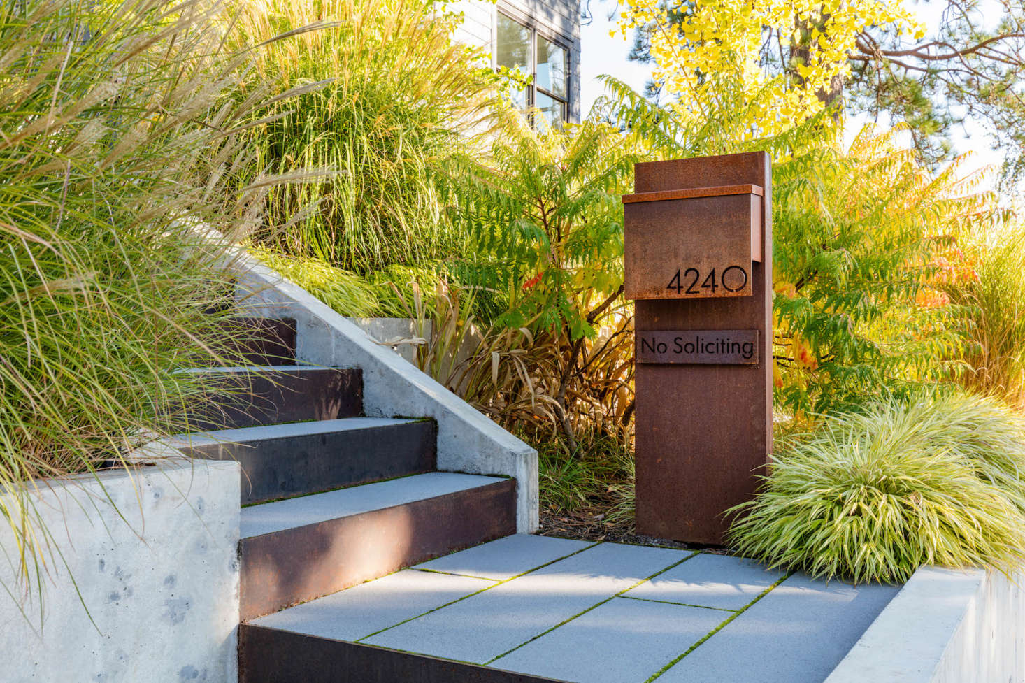 A new street-level custom mailbox clearly announces the house&#8