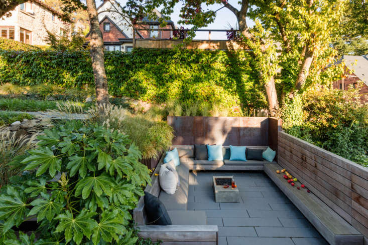 The courtyard is enclosed by plate steel retaining walls and ipe wood benches, and anchored by a fire pit.