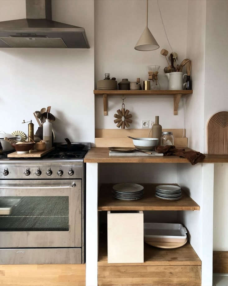 The kitchen, and nearly everything else in this charming home, was handmade by Tinta and Rutger Luhrman. See the house tour in Carved in Wood: The Bespoke Home of a Self-Taught Carpenter and an Interior Designer. Photograph by Tinta Luhrman.