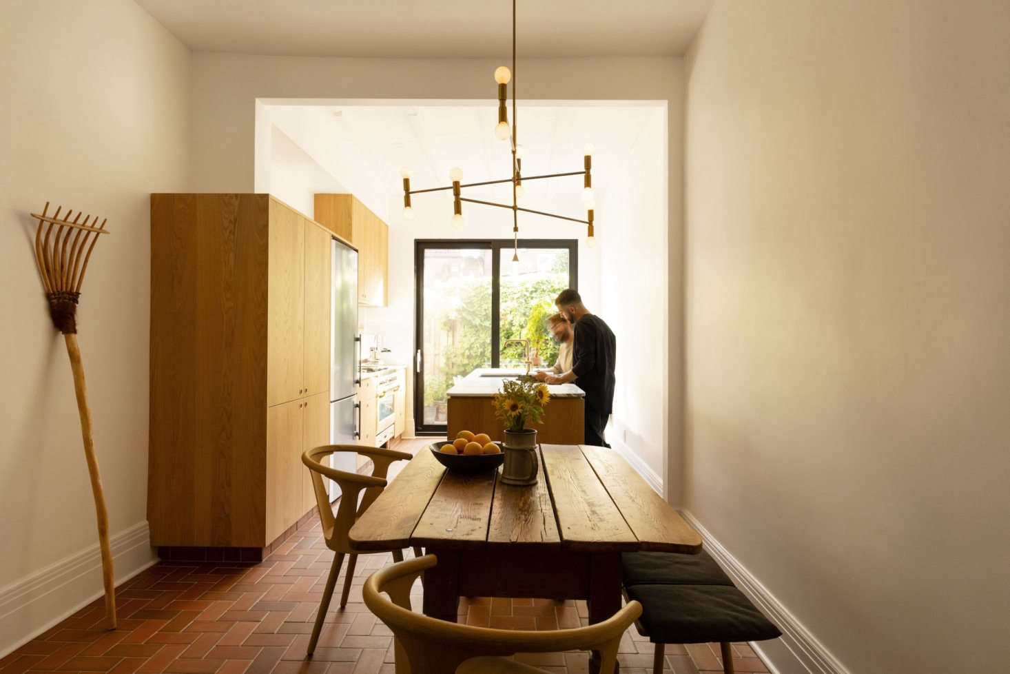 Architect Michael Godmer turned his compact townhome into a clever work-live space. Photograph by Maxime Brouillette, from An Architect's Narrow Townhouse in Montreal, Design Studio Included.