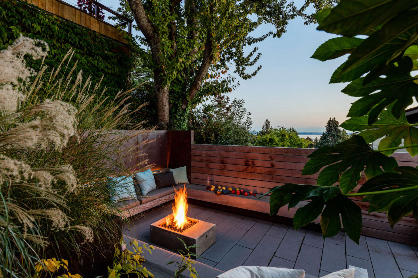 A peek of Lake Washington just beyond the wood wall. The concrete fire pit was designed by Wittman Estes.