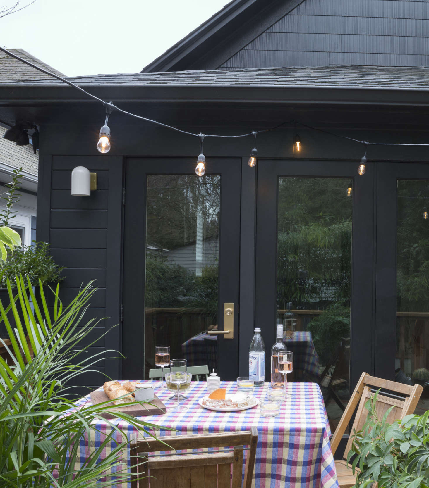 """Add charm to your outdoor dining table by covering it with a pretty tablecloth. Photograph courtesy of Schoolhouse Electric, from Urban Cottage: Designer and """"Creativepreneur"""" Angela Medlin's Chic Victorian in Portland, OR."""