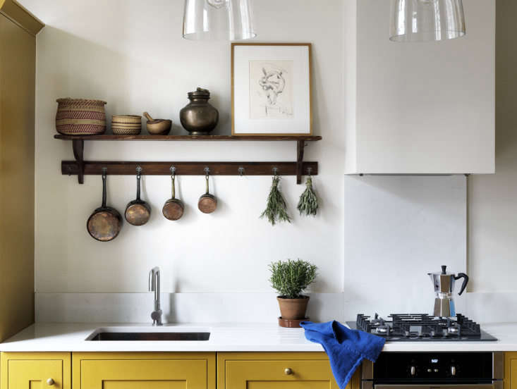 Lonika Chande does her mother proud by designing an elegant flat for her—including a bold yellow kitchen. Photograph by Simon Brown, courtesy of Lonika Chande Interior Design, from A London Designer's Apartment Remodel for a Demanding Client (Her Mother).