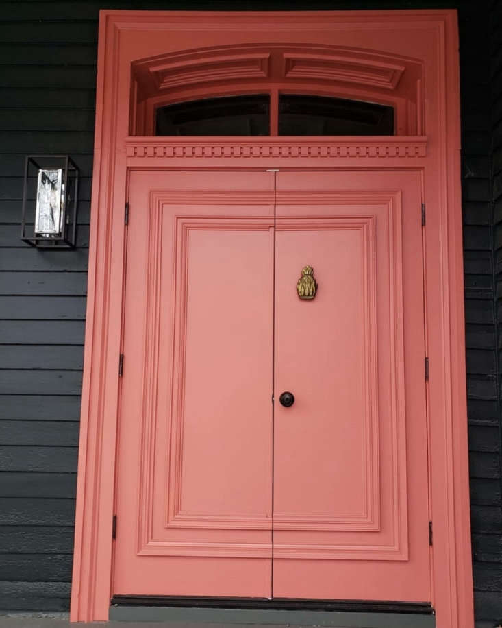 In lieu of the oddly institutional-looking front door, Maryline and her design partner, Mel Jones, designed an elegant Victorian version. &#8\2\20;After looking at equally expensive reproduction and original Victorian doors, we purchased a couple of hundred dollars worth of stock molding at Home Depot and Lowe&#8\2\17;s and applied them to two flat front doors.&#8\2\2\1; They then painted the doors Coral Bronze, by Benjamin Moore, to brighten the overall look. Photograph by Maryline Damour.