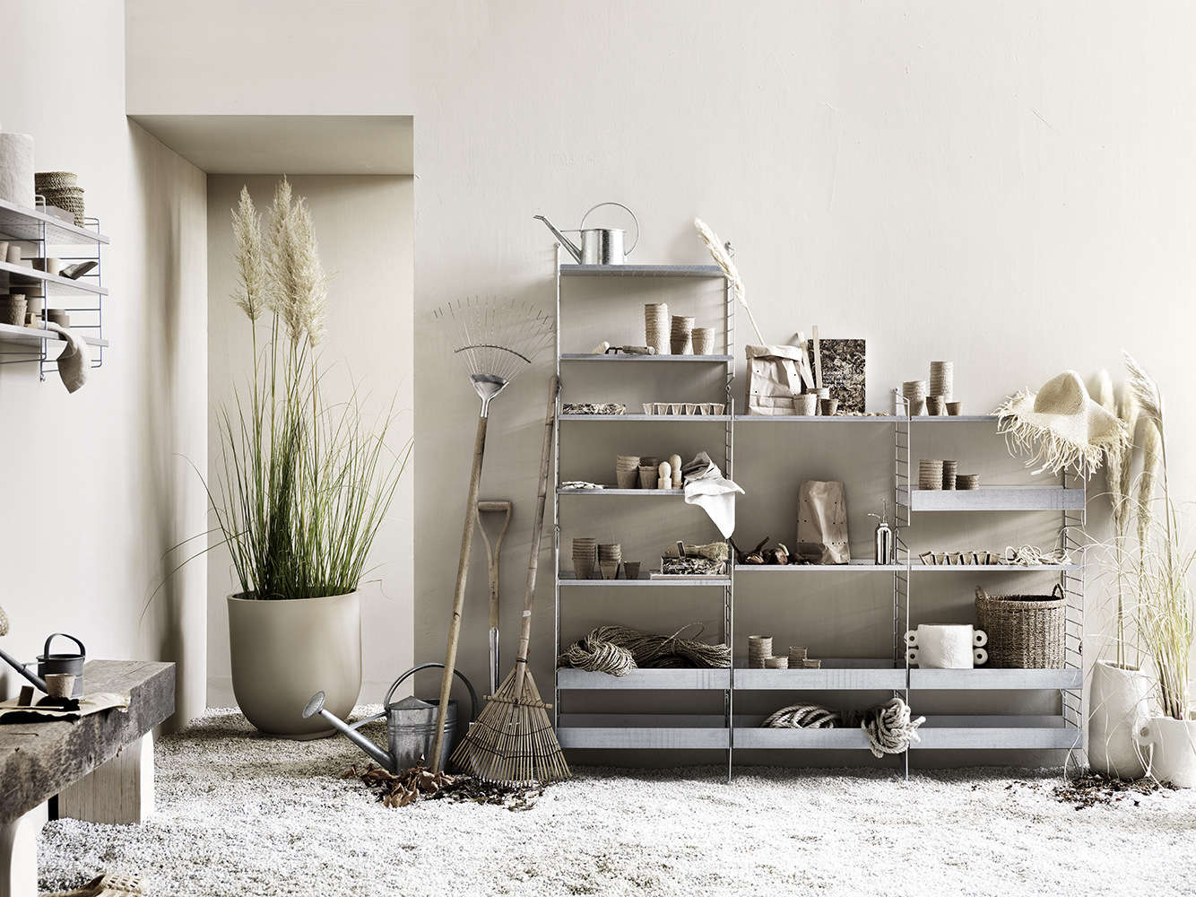 String shelving system in galvanized metal.