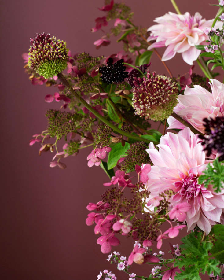 Pink and plum shades go especially well with the deep eggplant colors. This arrangement, by Susie Montagna, contains eggplants, scabiosa, dahlias, cosmos, allium, and more.