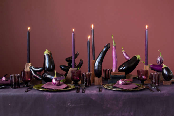 Eggplants alone can make for an arresting tablescape, especially when resting atop a DIY hand-painted purple canvas tablecloth.