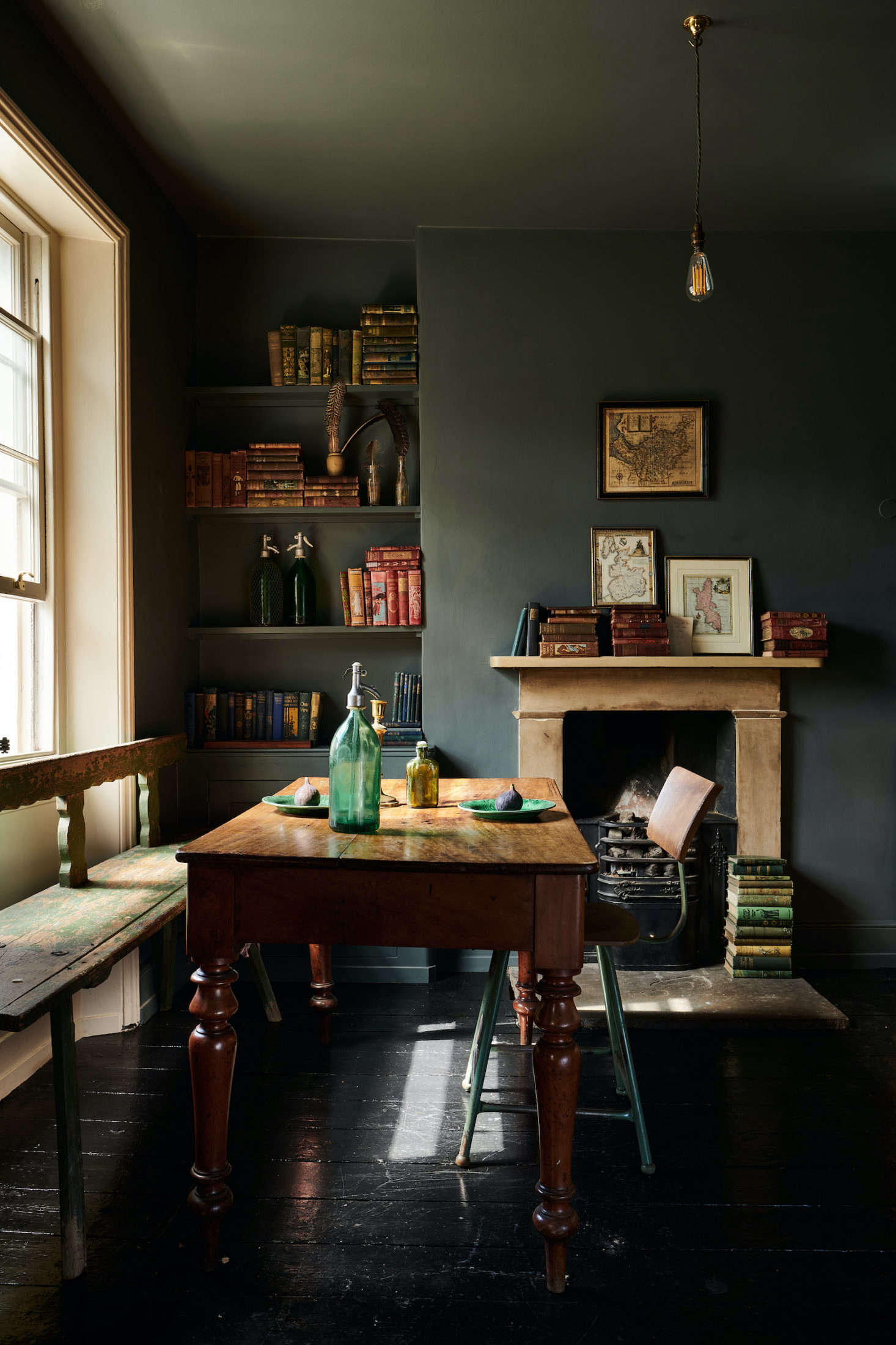 The breakfast nook of this deVOL kitchen in London feels rich with history thanks to an antique table and bench. See more of this artfully moody space in Kitchen of the Week: A London Kitchen Inspired by Traditional Haberdashery Stores. Photograph courtesy of deVOL.