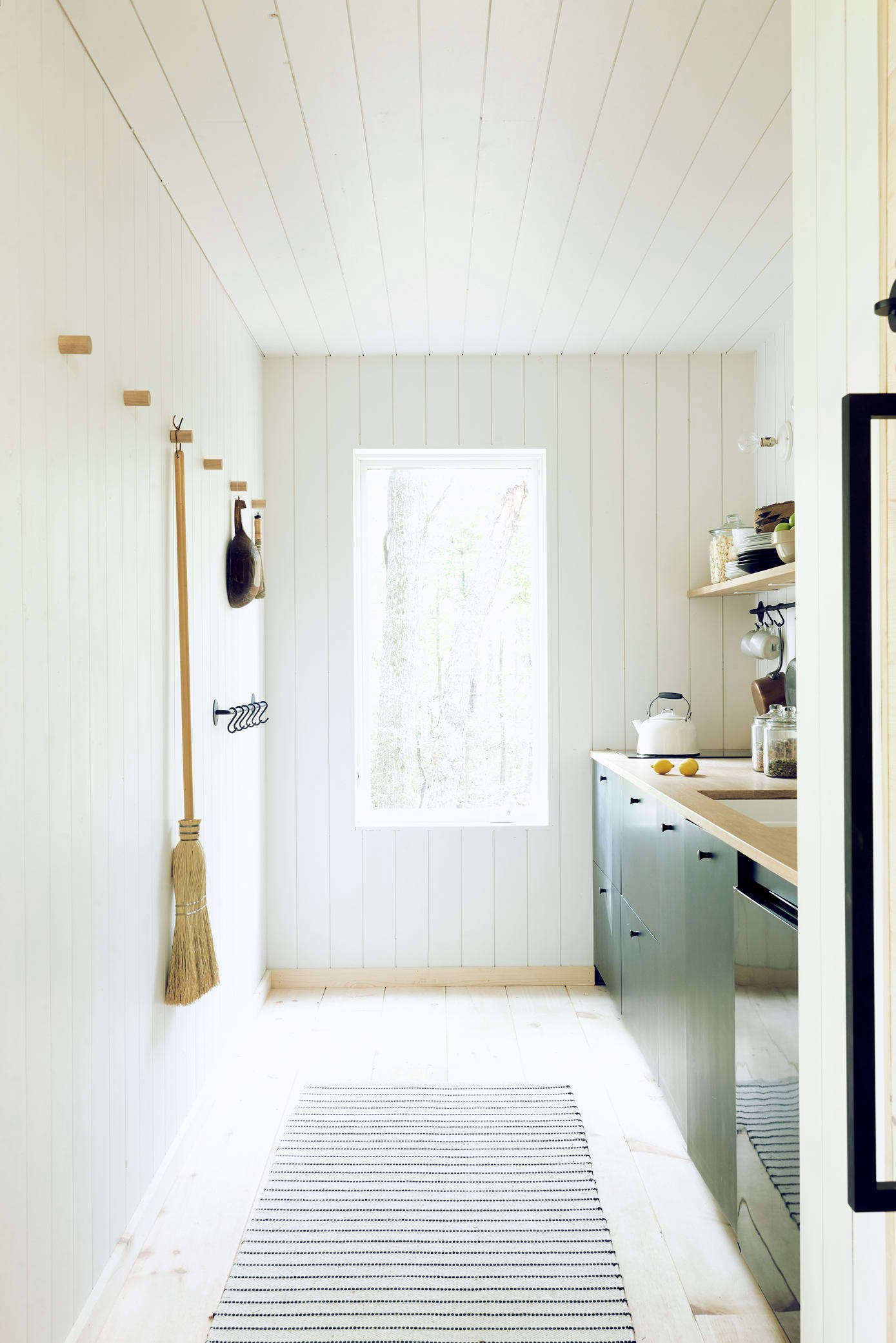 Utilitarian and attractive, invest in a durable broom crafted from natural materials. Photograph by Alexandra Ribar, from Hygge in Ohio: An Architect's Scandi-Inspired Off-the-Grid Hut.
