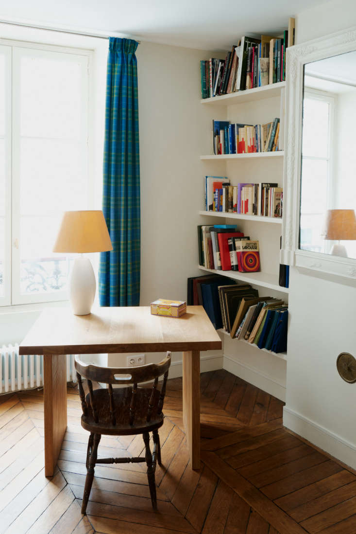 The key to a chic French-inspired room? Nothing perfect, nothing rigid. Instead place a desk at an angle and let books lean any which way, as in this nook from a Paris apartment in Before/After: Order and Pattern in a Spirited Paris Apartment Remodel by Two Young Architects. Photograph by Marvin Leuvrey and Charlotte Robin, courtesy of Studio Classico.