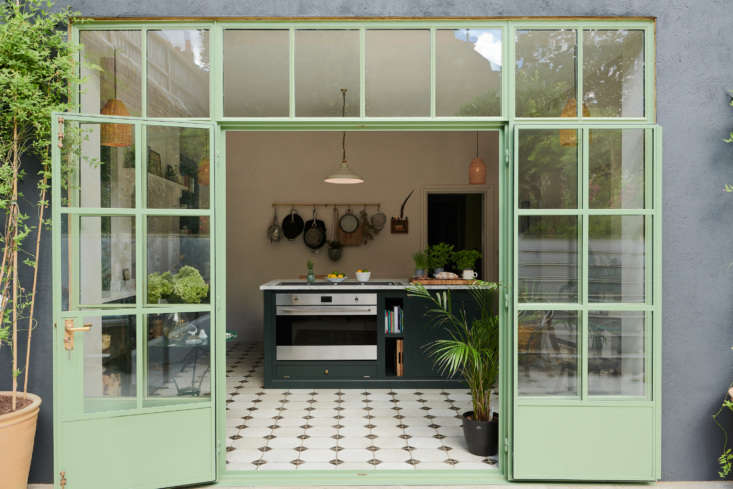 Steel windows and doors painted a mint-sage green adds to the cheerfulness of this deVOL kitchen. Photography courtesy ofdeVOL, from Kitchen of the Week: 'Wes Anderson Meets Provencal' in West London.