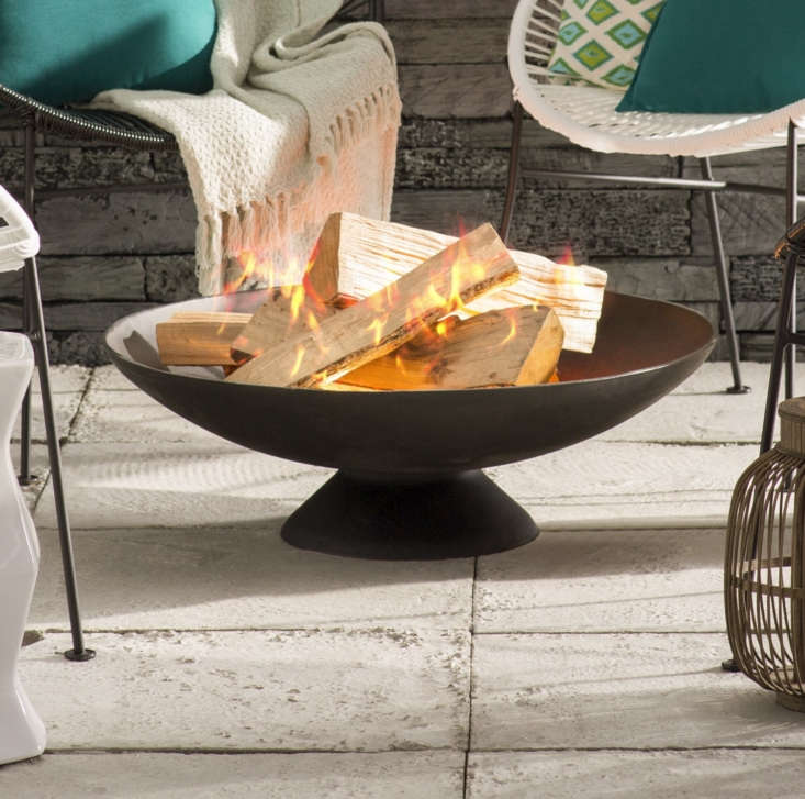 The streamlined Howland Cast Iron Fire Pit is currently on sale for \$\183 at AllModern.