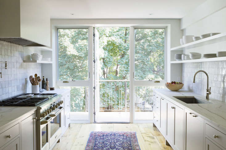 """A long and lean house Park Slope house gets a functional and bright kitchen in Kitchen of the Week: A Bright Addition with a """"Pantry Portal"""" for a Narrow Townhouse in Brooklyn. Photograph by Nicole Franzen, courtesy of Bangia Agostinho."""