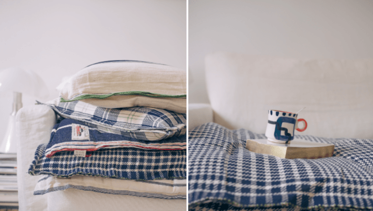 Layer in floppy pillows, throws, and bedrolls for a rumpled-refined look. Julie found a great source for these soft elements in Moismont: Textiles à la Français, by Way of India.