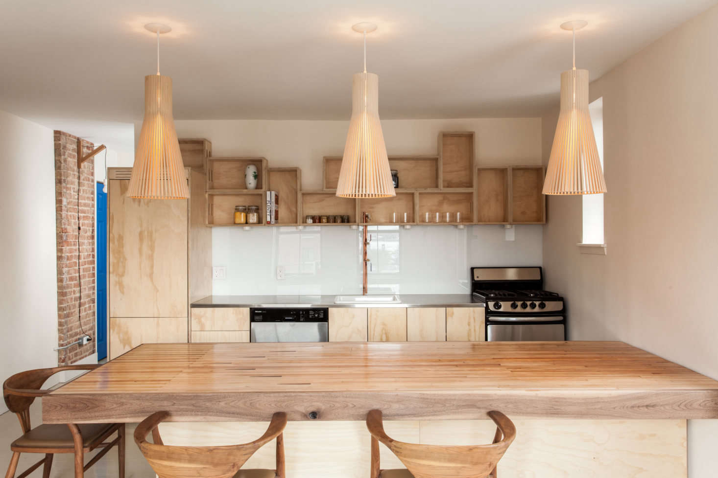 An unconventional, rustic-meets-urban kitchen in Brooklyn. Photograph by Peter Dressel, courtesy of CO Adaptive, from Kitchen of the Week: A Clever Kitchen Built from Affordable and Recycled Materials.