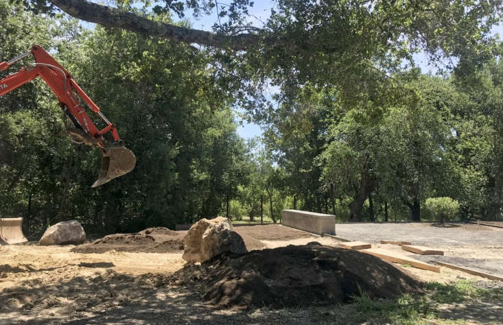 """When Terremoto's team first arrived at the property, the house had just been built, leaving the surrounding land feeling like a barren construction site. As Story says, """"the main feature was a giant dumpster, accented by bare patches of compacted earth."""""""