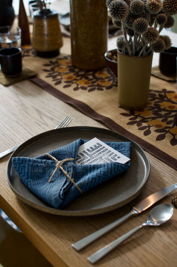 &#8\2\20;Don't be afraid to mix patterns, like stylized botanicals with geometrics in varying scales,&#8\2\2\1; says the couple. &#8\2\20;We paired aDanish Södahl Designs runner we picked up at an estate salewith a few different napkins from our newblock-printed collection.&#8\2\2\1; To take a look at the collection of napkins, pillows, and more, head to The Imaginary House.
