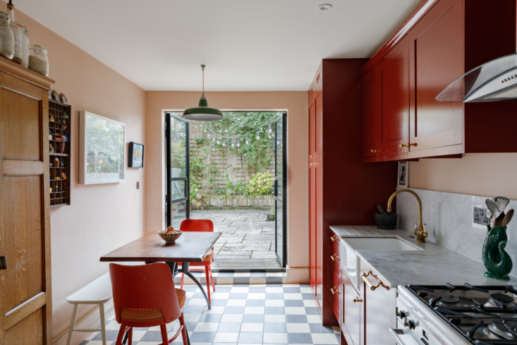 A very merry space, thanks to tomato-red cabinets in this London kitchen designed by Adam Bray. Photograph courtesy of The Modern House, from Kitchen of the Week: Going Big with Color in a Small Space.