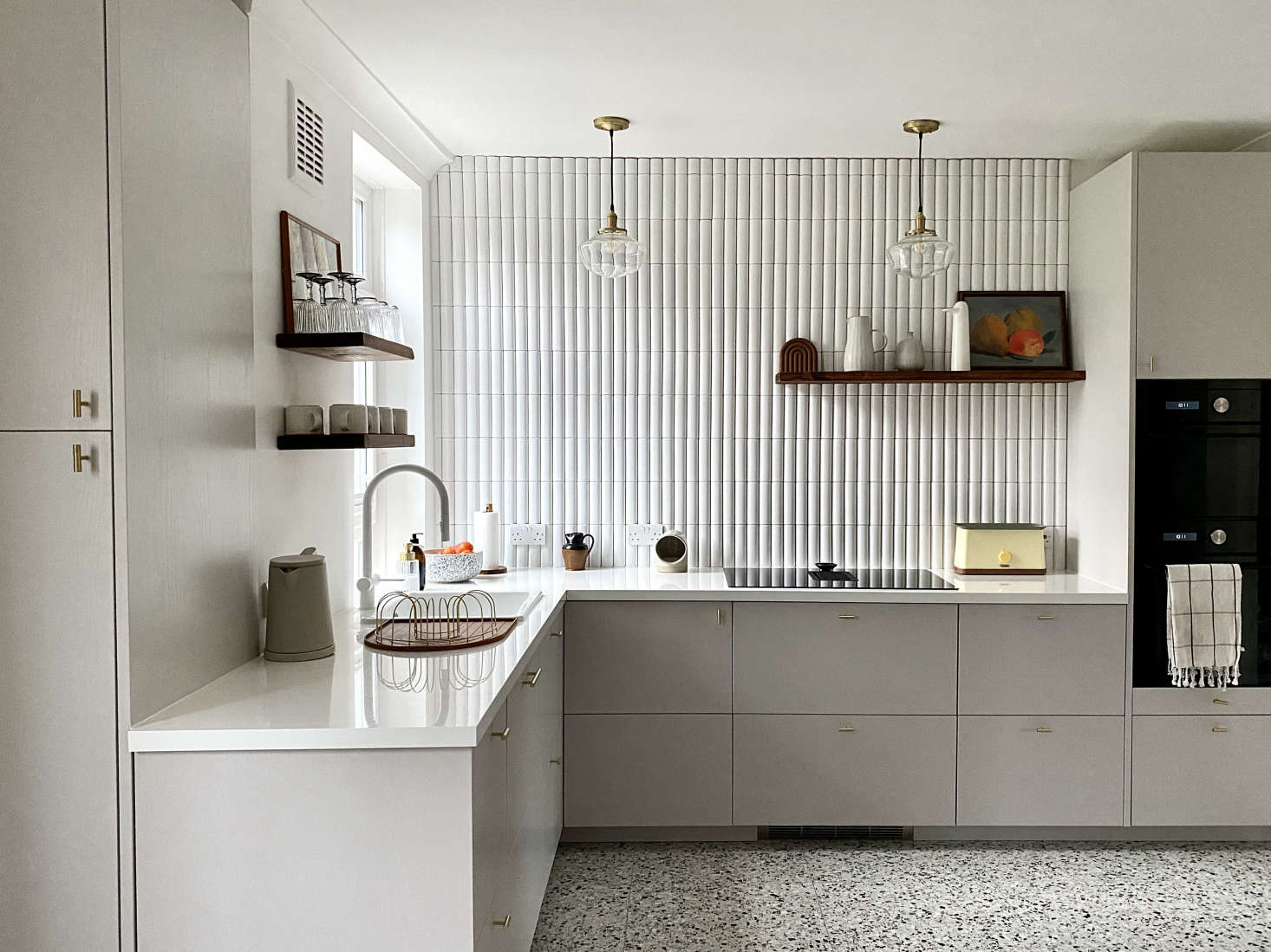 Another high/low kitchen, thanks to Ikea base cabinets and fronts by Naked Doors. The homeowners here also saved by choosing Ikea appliances. Photograph by Ferren Gipson, from Kitchen of the Week: An American In London Creates Her Dream Ikea Hack Kitchen.