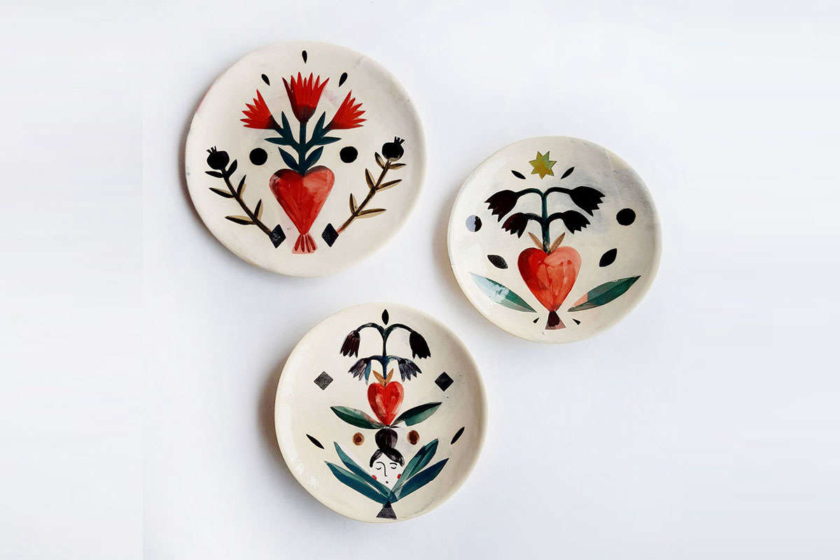 Not ready to commit to color? Start with the little things, like these painted earthenware plates that can brighten your dining table or wall. See Object of Desire: Whimsical Painted Plates by a French Ceramicist.