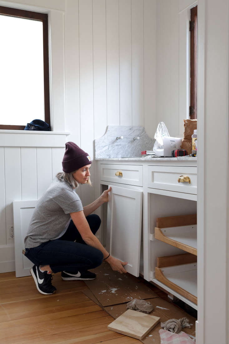Advice and secrets from the remodeling experts behind The Grit and The Polish on how to paint cabinets. Photograph courtesy of The Grit and The Polish, from DIY: Kitchen Cabinet Painting Tips from Two House Rehab Warriors.