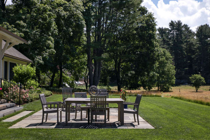 The outdoor dining terrace was made using natural cleft bluestone salvaged from the original house.