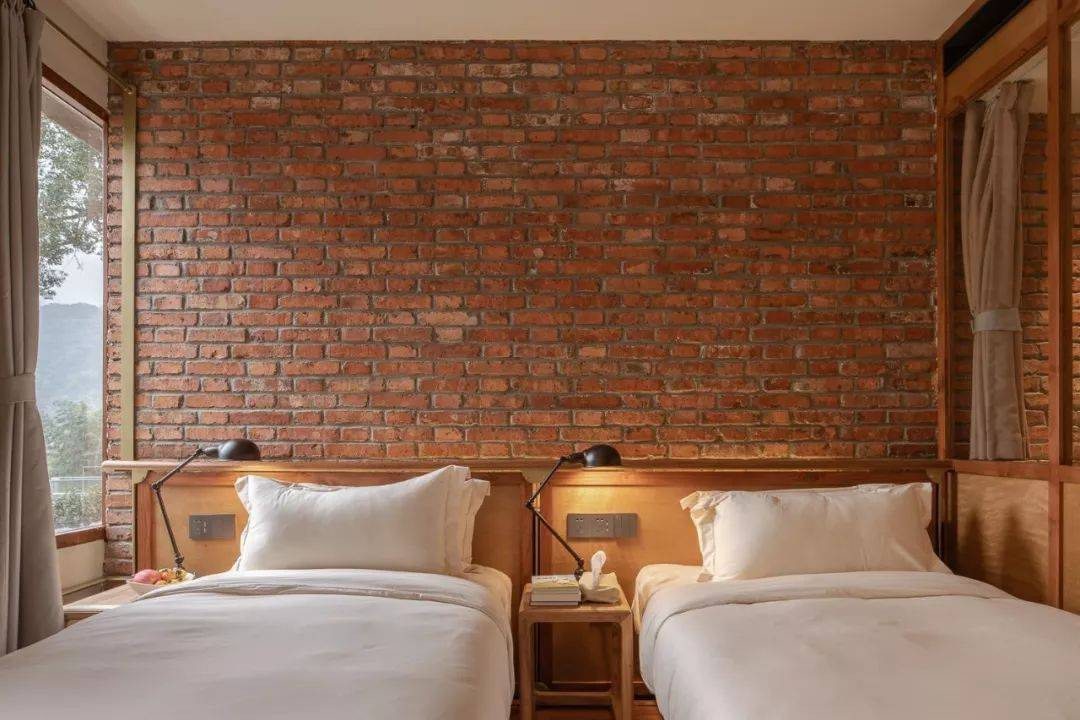 A tidy sleeping alcove in Lost Villa Qinyong Hotel. Photograph by Hao Chen via Lost Villa Qinyong, from Thoughtful Reuse: A Primary School Turned Serene Hotel in Zhejiang Province.