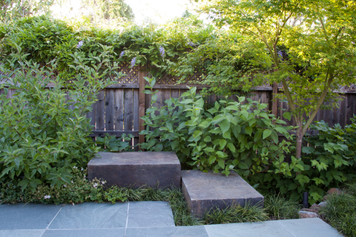 The \24&#8\243; square slate paving, the concrete blocks, and the verdant plants connect and unify the space.