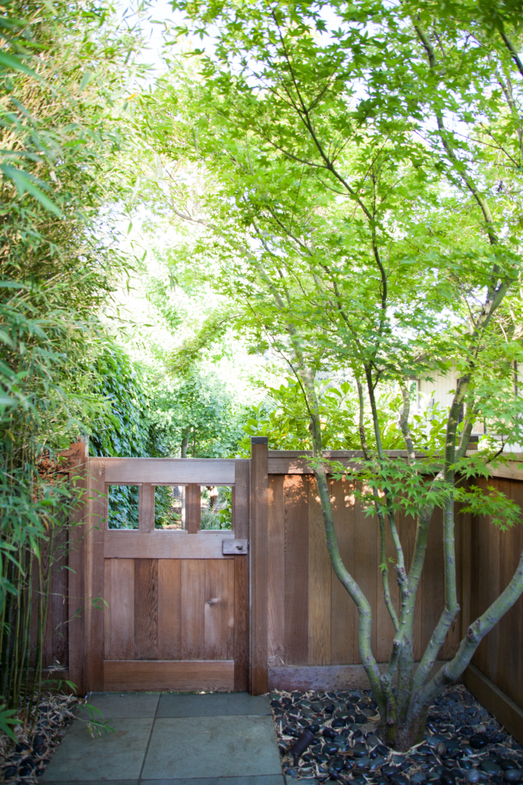 The refined entry fence and gates, designed by Ken Morita, use Japanese joinery techniques.
