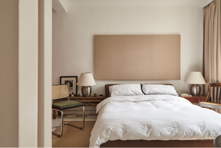 A neutral, but not boring in the least, bedroom in An Eclectic Home in Shanghai. Photograph courtesy of Studio Glume.