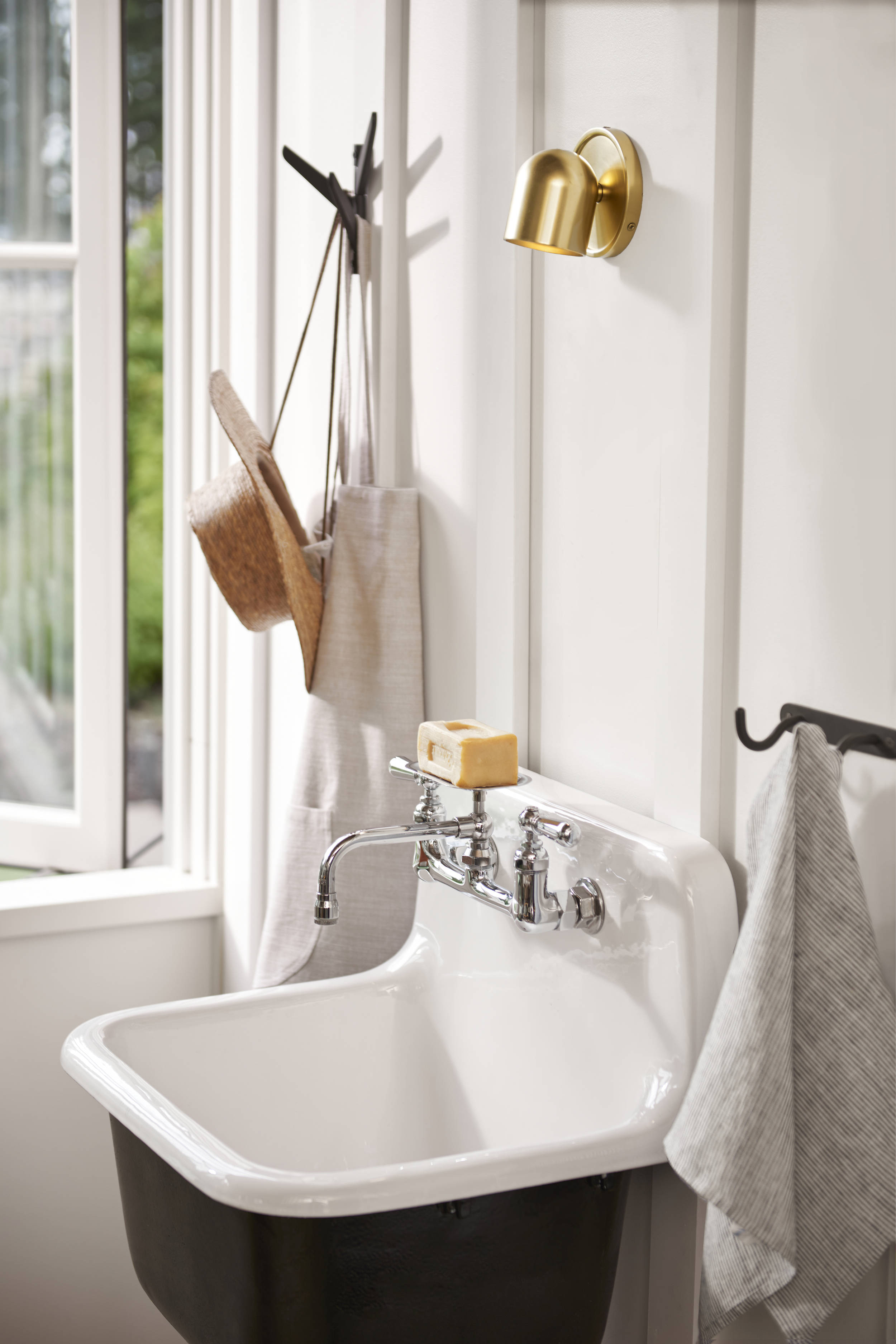 Don't forget an accessible sink for easy clean-up. This is the Grizzly Cast Iron Utility Sink with Drain and Faucet ($src=