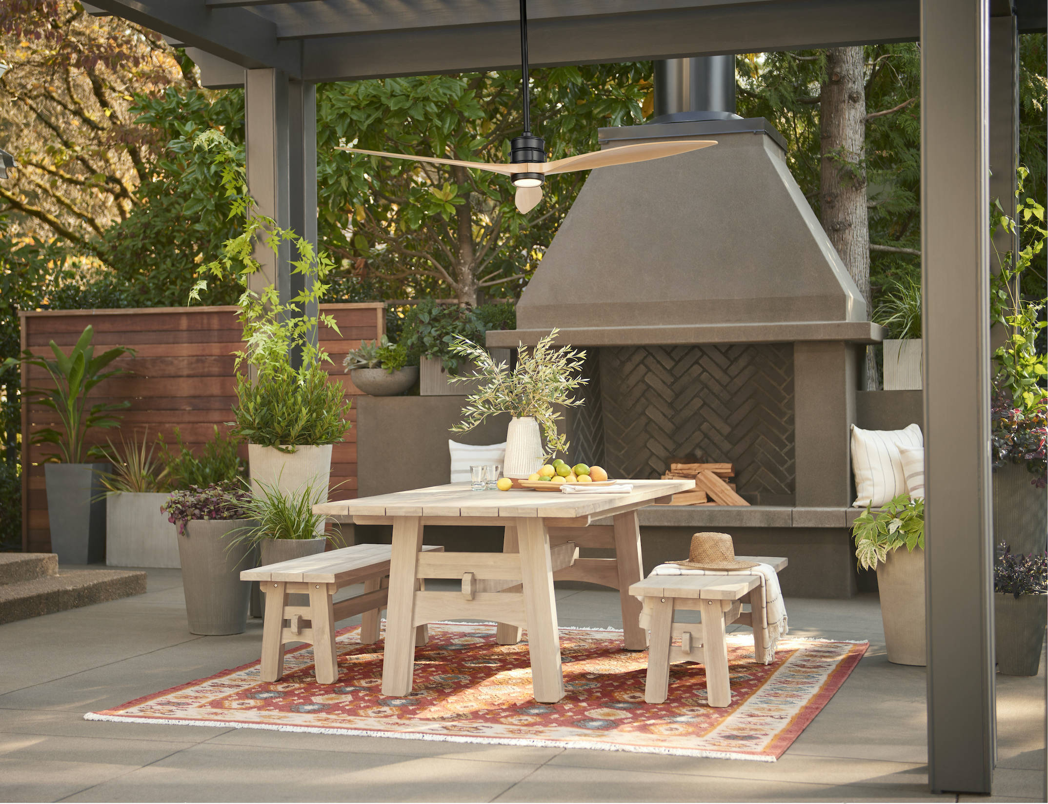 Outdoor oases need good light and some air circulation too—especially in the hot midday sun or to keep bugs away once dusk falls. The fan is the sleek, energy-efficient Falcon LED Ceiling Fan in Matte Black and Natural ($979). (Also available: the Ronde Teak Dining Table and Ronde Teak Bench.)