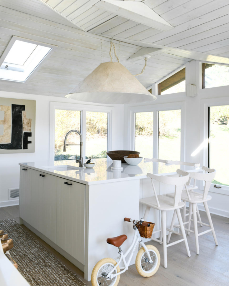 HGTV star Leanne Ford had an oversized paper-mâché lampshade made for this airy kitchen. See how much it cost in Kitchen of the Week: A Budget Remodel That Looks High-End, Thanks to DIY and Clever Design. Photograph by Erin Kelly, courtesy of Leanne Ford Interiors.